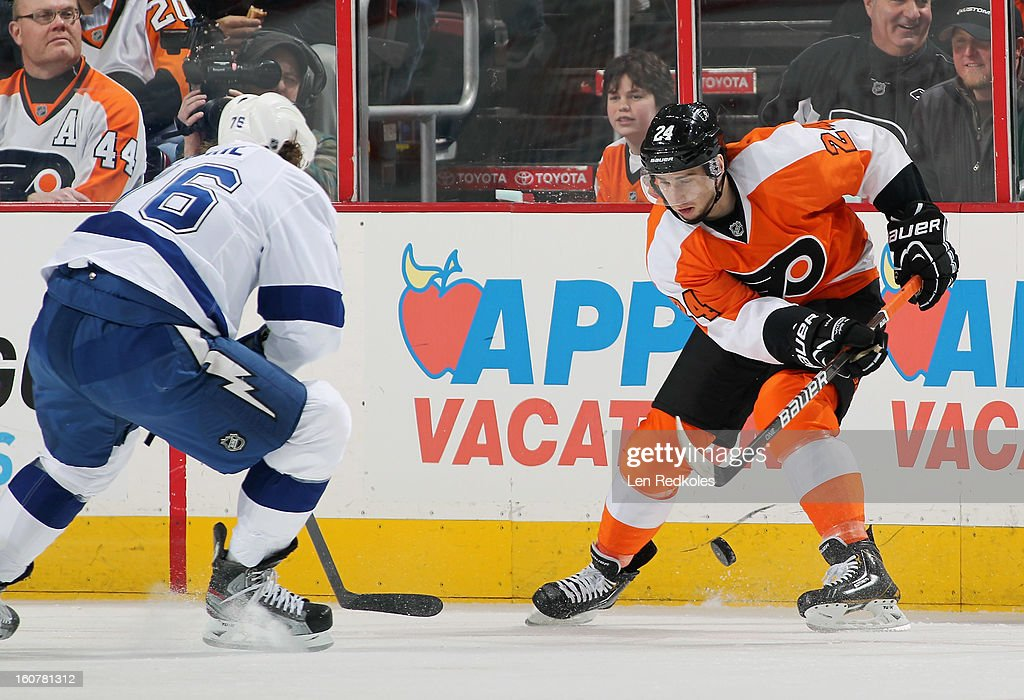 Matt Read #24 of the Philadelphia Flyers attempts to control the puck while being pursued by Teddy Purcell #16 of the Tampa Bay Lightning on February 5, 2013 at the Wells Fargo Center in Philadelphia, Pennsylvania.