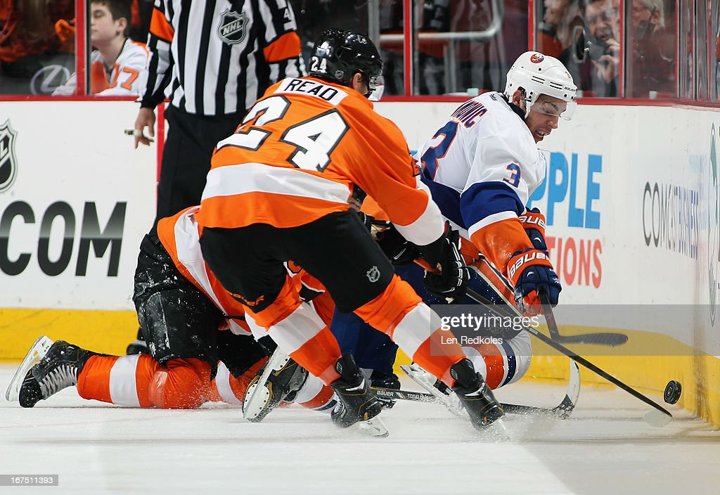 <a gi-track='captionPersonalityLinkClicked' href=/galleries/search?phrase=Matt+Read&family=editorial&specificpeople=6783206 ng-click='$event.stopPropagation()'>Matt Read</a> #24 of the Philadelphia Flyers battles along the boards for the loose puck with <a gi-track='captionPersonalityLinkClicked' href=/galleries/search?phrase=Travis+Hamonic&family=editorial&specificpeople=4605791 ng-click='$event.stopPropagation()'>Travis Hamonic</a> #3 of the New York Islanders on April 25, 2013 at the Wells Fargo Center in Philadelphia, Pennsylvania. The Flyers went on to defeat the Islanders 2-1.