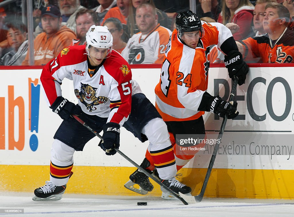 <a gi-track='captionPersonalityLinkClicked' href=/galleries/search?phrase=Matt+Read&family=editorial&specificpeople=6783206 ng-click='$event.stopPropagation()'>Matt Read</a> #24 of the Philadelphia Flyers battles for the loose puck with <a gi-track='captionPersonalityLinkClicked' href=/galleries/search?phrase=Marcel+Goc&family=editorial&specificpeople=541626 ng-click='$event.stopPropagation()'>Marcel Goc</a> #57 of the Florida Panthers on October 8, 2013 at the Wells Fargo Center in Philadelphia, Pennsylvania. The Flyers went on to defeat the Panthers 2-1.