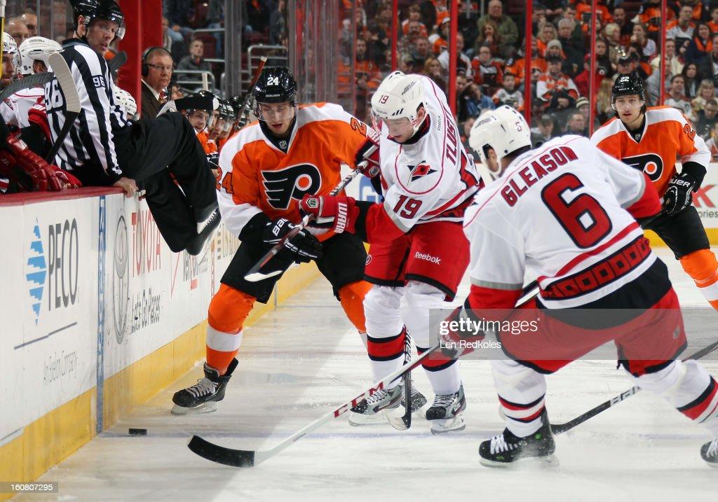 Matt Read #24 of the Philadelphia Flyers battles for the puck against Jiri Tlusty #19 and Tim Gleason #6 of the Carolina Hurricanes on February 2, 2013 at the Wells Fargo Center in Philadelphia, Pennsylvania.