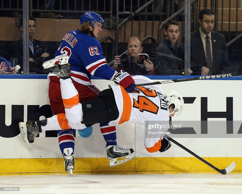 <a gi-track='captionPersonalityLinkClicked' href=/galleries/search?phrase=Matt+Read&family=editorial&specificpeople=6783206 ng-click='$event.stopPropagation()'>Matt Read</a> #24 of the Philadelphia Flyers bounces off <a gi-track='captionPersonalityLinkClicked' href=/galleries/search?phrase=Carl+Hagelin&family=editorial&specificpeople=4465394 ng-click='$event.stopPropagation()'>Carl Hagelin</a> #62 of the New York Rangers during the first period in Game One of the First Round of the 2014 NHL Stanley Cup Playoffs at Madison Square Garden on April 17, 2014 in New York City.