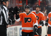Matt Read of the Philadelphia Flyers celebrates a second period goal against the Washington Capitals on December 17 2013 at the Wells Fargo Center in...