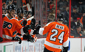 Matt Read of the Philadelphia Flyers celebrates a third period goal with teammates against the Chicago Blackhawks on March 25 2015 at the Wells Fargo...