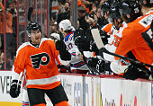 Matt Read of the Philadelphia Flyers celebrates his first period goal against the New York Rangers with his teammates on the bench on February 28...
