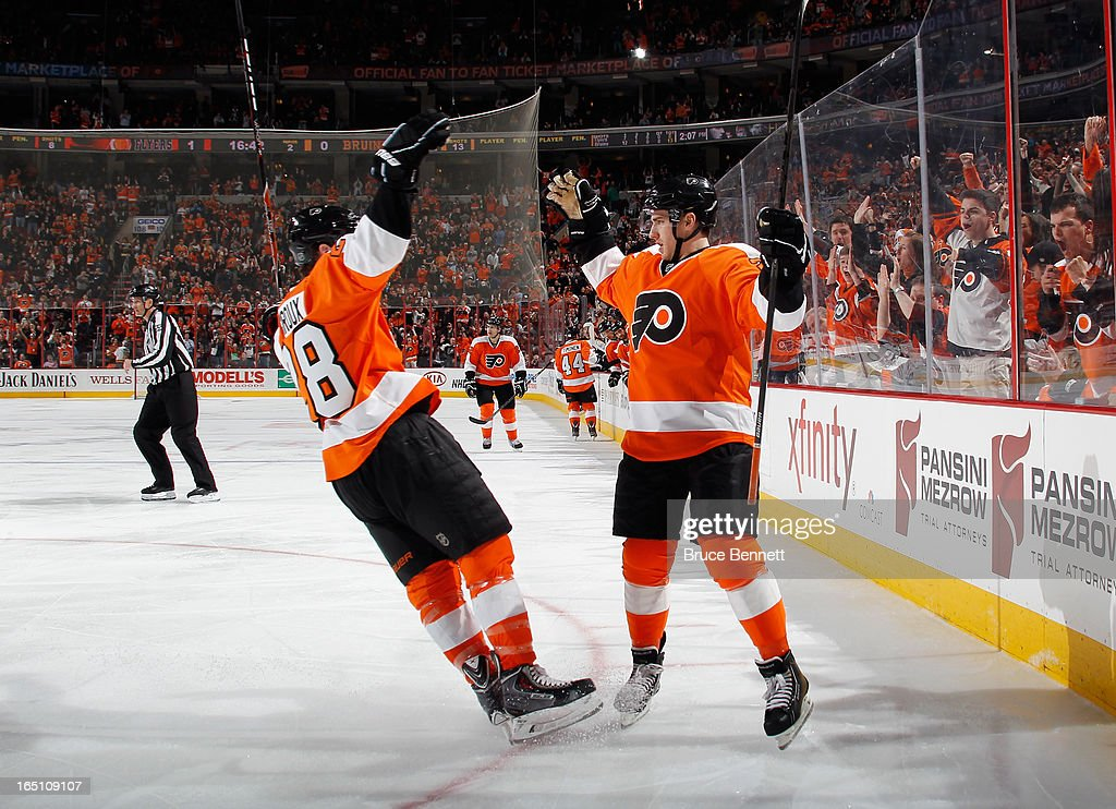 Matt Read of the Philadelphia Flyers celebrates his second goal at 318 of the second period against the Boston Bruins along with Claude Giroux at the...