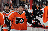 Matt Read of the Philadelphia Flyers celebrates Scott Laughton's first period goal with teammates against the Arizona Coyotes on February 27 2016 at...