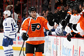 Matt Read of the Philadelphia Flyers celebrates with teammates after scoring a goal against the Toronto Maple Leafs during the first period at Wells...