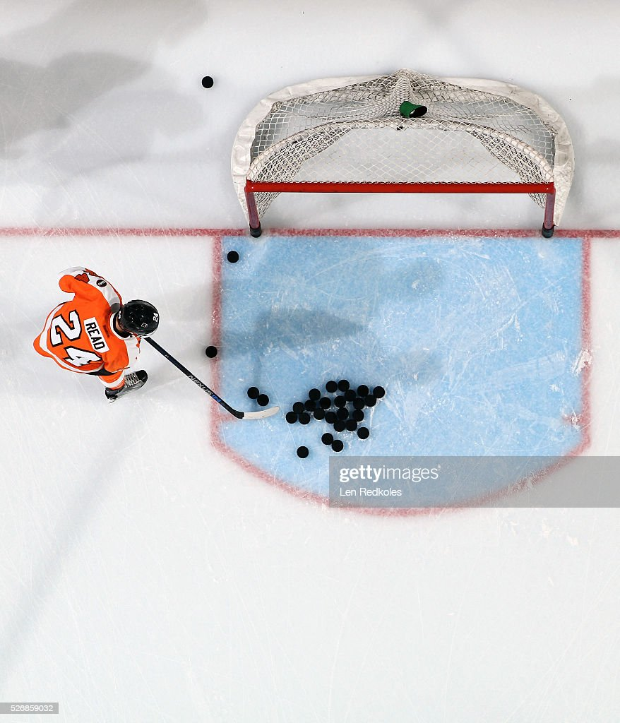 Matt Read of the Philadelphia Flyers clears the pucks out of the crease during warmups against the Washington Capitals in Game Six of the Eastern...