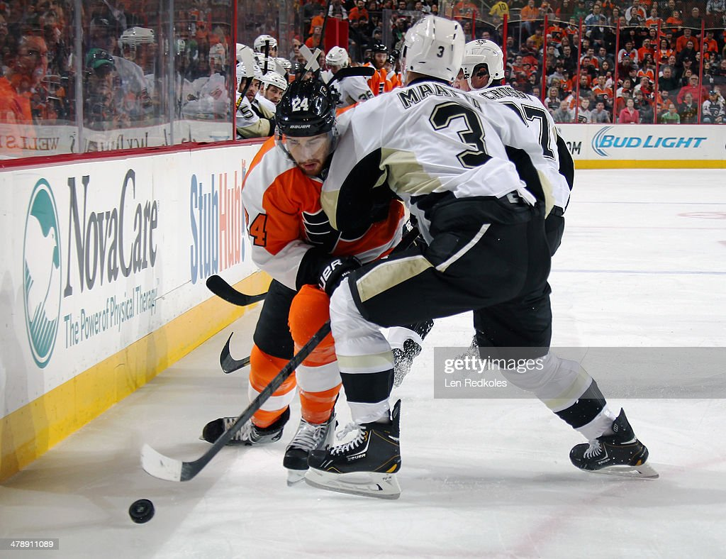 Matt Read #24 of the Philadelphia Flyers collides with Olli Maatta #3 of the Pittsburgh Penguins as he tries to control the loose puck on March 15, 2014 at the Wells Fargo Center in Philadelphia, Pennsylvania.