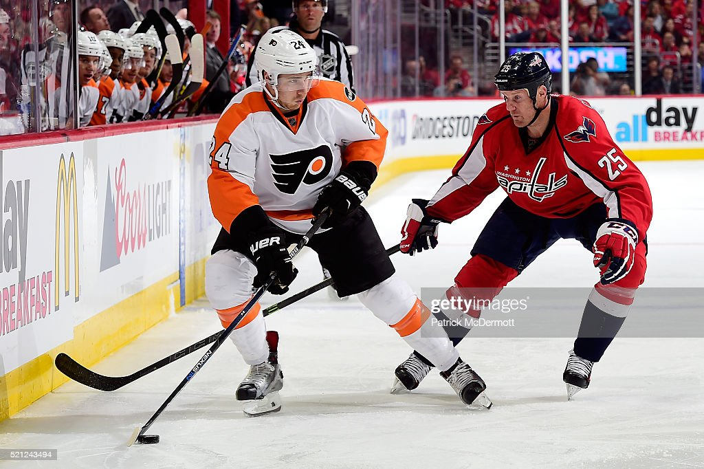 Matt Read of the Philadelphia Flyers controls the puck against Jason Chimera of the Washington Capitals in the second period in Game One of the...