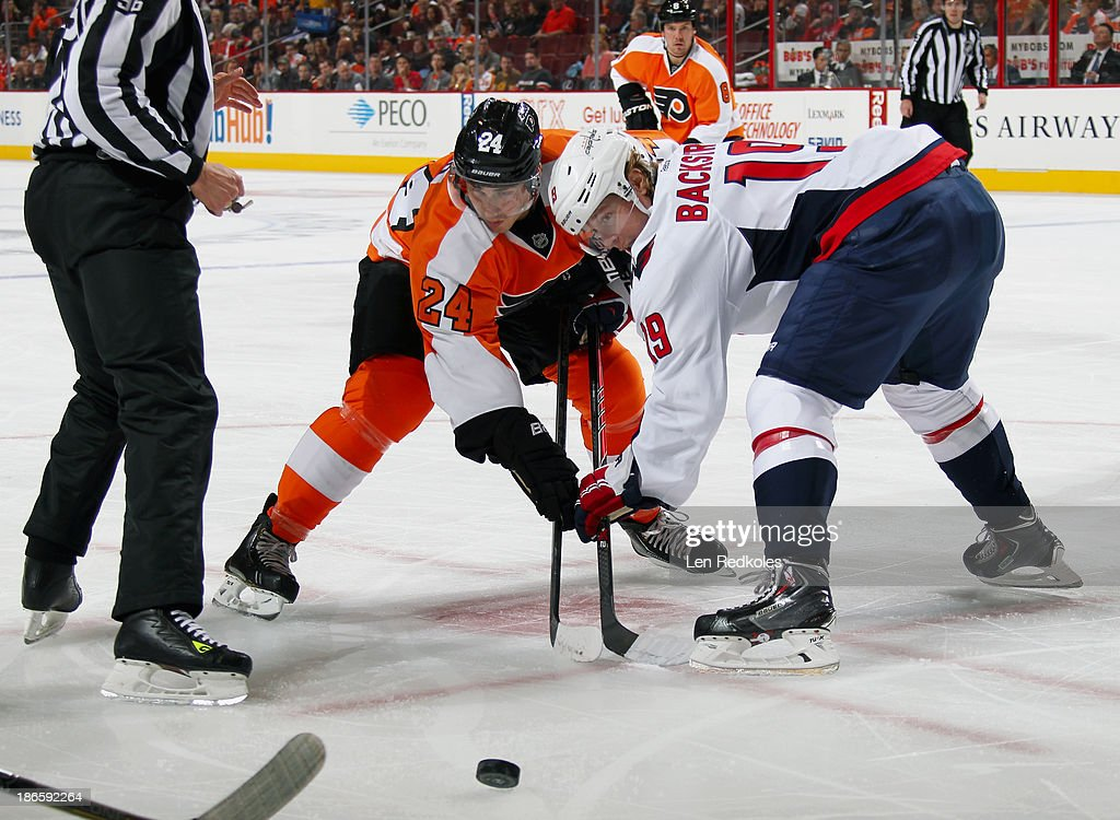 <a gi-track='captionPersonalityLinkClicked' href=/galleries/search?phrase=Matt+Read&family=editorial&specificpeople=6783206 ng-click='$event.stopPropagation()'>Matt Read</a> #24 of the Philadelphia Flyers faces off with Nicklas Backstrom #19 of the Washington Capitals on November 1, 2013 at the Wells Fargo Center in Philadelphia, Pennsylvania. The Capitals went on to defeat the Flyers 7-0.