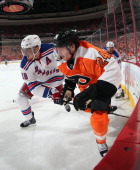 Matt Read of the Philadelphia Flyers is checked by Marc Staal of the New York Rangers in Game Three of the First Round of the 2014 NHL Stanley Cup...