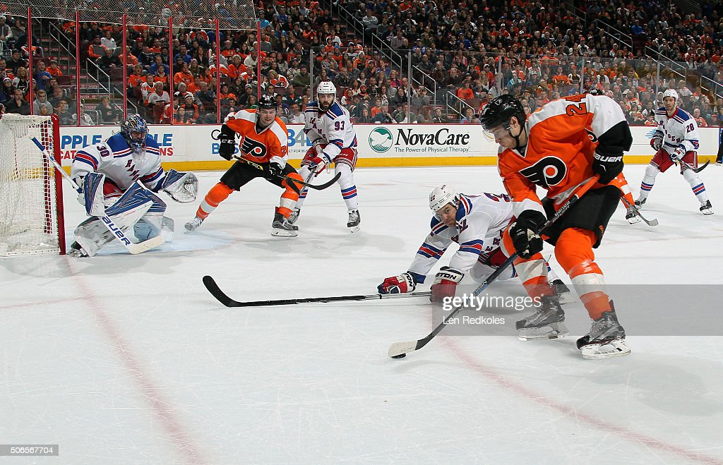 <a gi-track='captionPersonalityLinkClicked' href=/galleries/search?phrase=Matt+Read&family=editorial&specificpeople=6783206 ng-click='$event.stopPropagation()'>Matt Read</a> #24 of the Philadelphia Flyers looks to pass the puck to teammate <a gi-track='captionPersonalityLinkClicked' href=/galleries/search?phrase=Scott+Laughton&family=editorial&specificpeople=8050728 ng-click='$event.stopPropagation()'>Scott Laughton</a> #21 against <a gi-track='captionPersonalityLinkClicked' href=/galleries/search?phrase=Brian+Boyle+-+Hockey+sur+glace&family=editorial&specificpeople=8986264 ng-click='$event.stopPropagation()'>Brian Boyle</a> #22, <a gi-track='captionPersonalityLinkClicked' href=/galleries/search?phrase=Keith+Yandle&family=editorial&specificpeople=606912 ng-click='$event.stopPropagation()'>Keith Yandle</a> #93 and <a gi-track='captionPersonalityLinkClicked' href=/galleries/search?phrase=Henrik+Lundqvist&family=editorial&specificpeople=217958 ng-click='$event.stopPropagation()'>Henrik Lundqvist</a> #30 of the New York Rangers on January 16, 2016 at the Wells Fargo Center in Philadelphia, Pennsylvania.