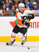 Matt Read of the Philadelphia Flyers passes the puck during NHL game action against the Toronto Maple Leafs February 20 2016 at Air Canada Centre in...