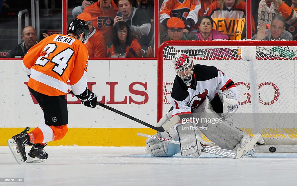 Matt Read #24 of the Philadelphia Flyers scores a shoot-out goal against Johan Hedberg #1 of the New Jersey Devils on March 15, 2013 at the Wells Fargo Center in Philadelphia, Pennsylvania. The Flyers went on to defeat the Devils 2-1 in a shoot-out.