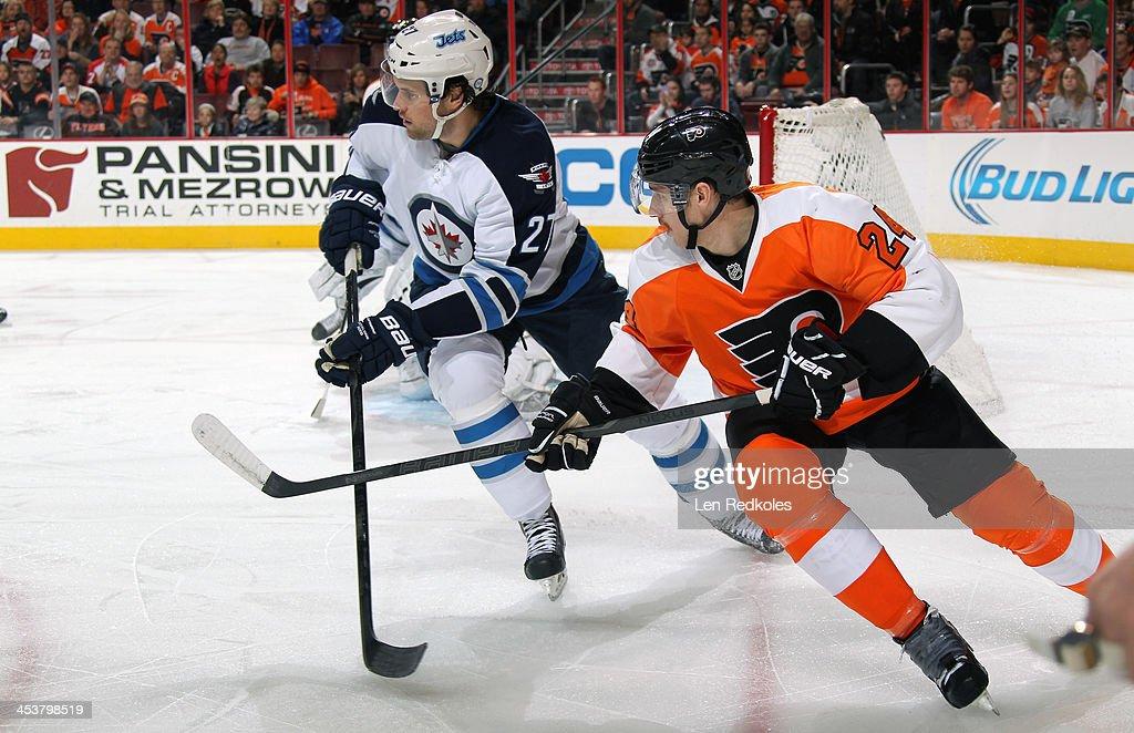Matt Read #24 of the Philadelphia Flyers skates against Eric Tangradi #27 of the Winnipeg Jets on November 29, 2013 at the Wells Fargo Center in Philadelphia, Pennsylvania.