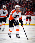 Matt Read of the Philadelphia Flyers skates against the New Jersey Devils at the Prudential Center on March 13 2013 in Newark New Jersey The Devils...