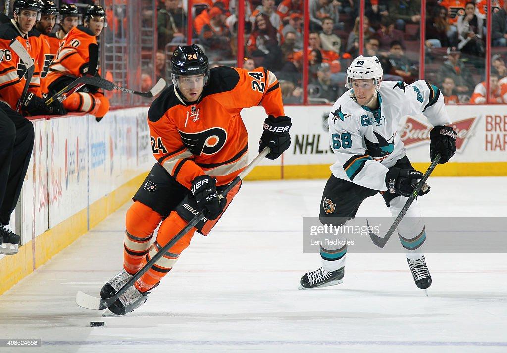 Matt Read of the Philadelphia Flyers skates the puck against Melker Karlsson of the San Jose Sharks on March 28 2015 at the Wells Fargo Center in...