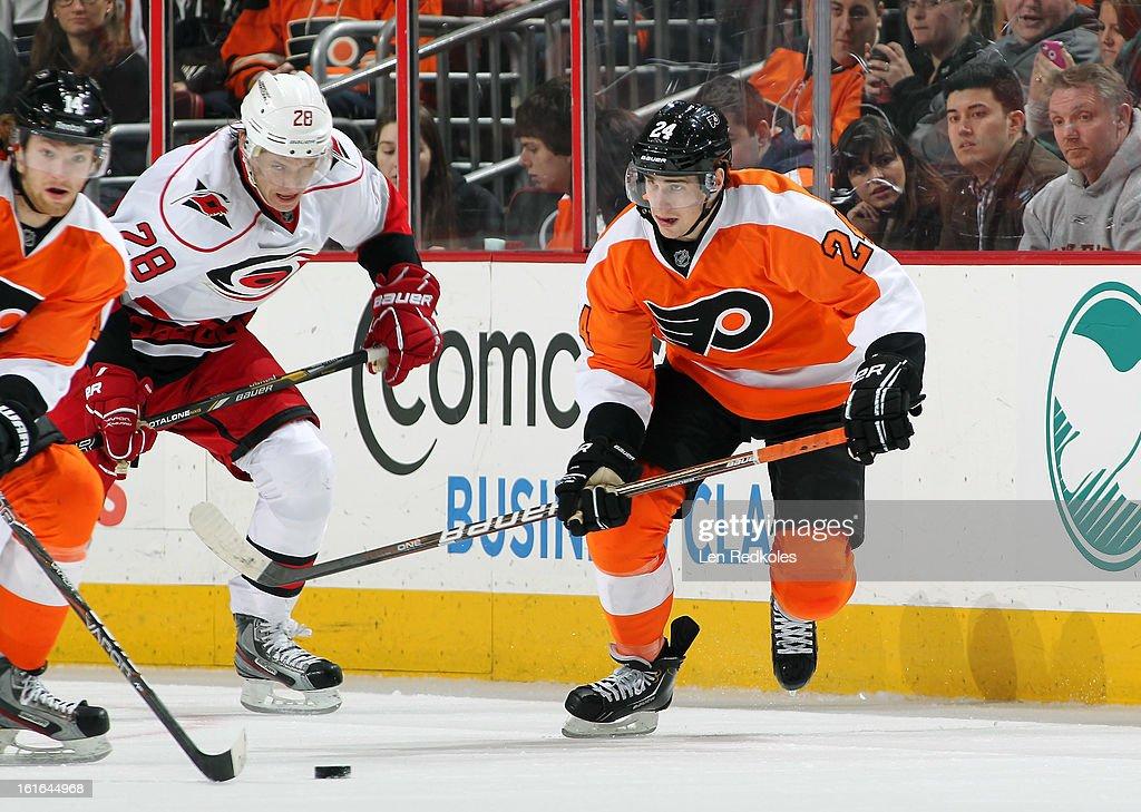 Matt Read #28 of the Philadelphia Flyers skates the puck against Alexander Semin #28 of the Carolina Hurricanes on February 9, 2013 at the Wells Fargo Center in Philadelphia, Pennsylvania.