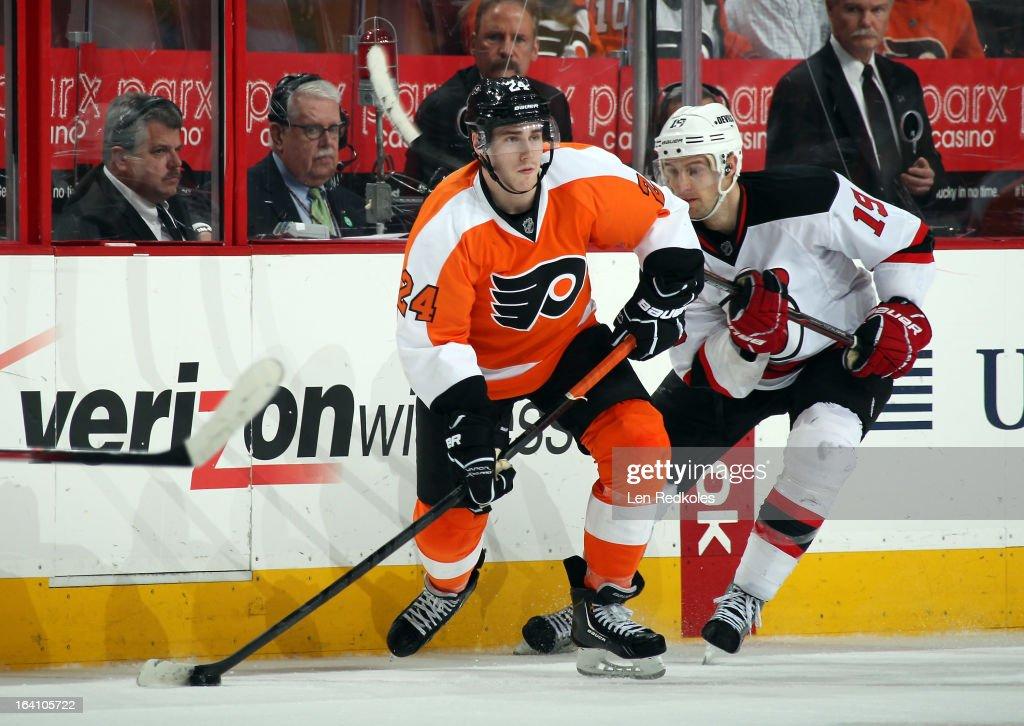 Matt Read #24 of the Philadelphia Flyers skates the puck against Travis Zajac #19 of the New Jersey Devils on March 15, 2013 at the Wells Fargo Center in Philadelphia, Pennsylvania.