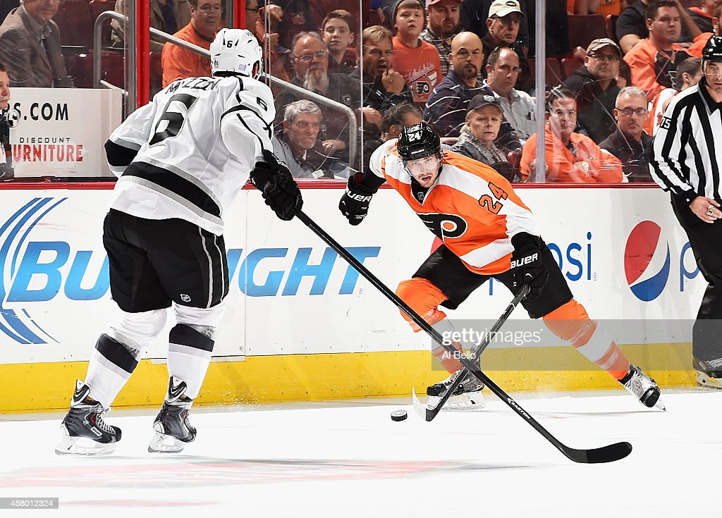 Matt Read #24 of the Philadelphia Flyers skates with the puck against Jake Muzzin #6 of the Los Angeles Kings during their game at the Wells Fargo Center on October 28, 2014 in Philadelphia, Pennsylvania.