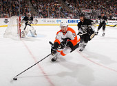 Matt Read of the Philadelphia Flyers tries to change direction in front of Kris Letang of the Pittsburgh Penguins during the first period on November...