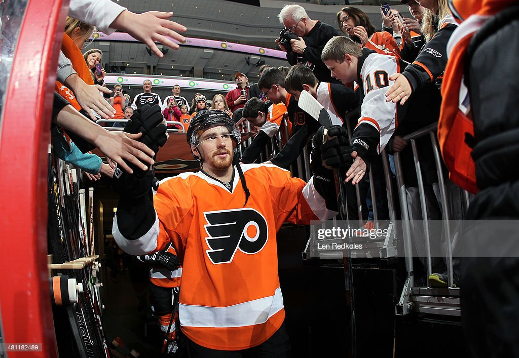 Matt Read of the Philadelphia Flyers walks though his fans to the ice surface for the pregame warmups against the St Louis Blues on March 22 2014 at...