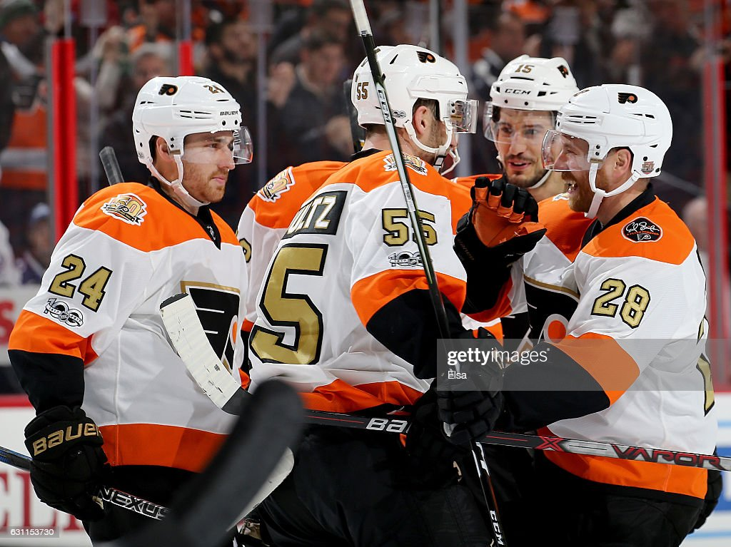 Matt Read #24,Nick Schultz #55,Michael Del Zotto #15 and Claude Giroux #28 of the Philadelphia Flyers celebrate Michael Raffl's goal in the second period against the Tampa Bay Lightning on January 7, 2017 at Wells Fargo Center in Philadelphia, Pennsylvania.