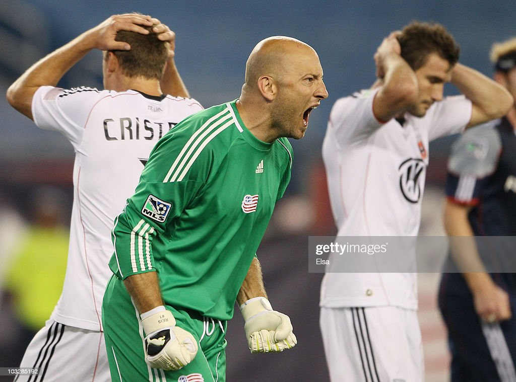 <a gi-track='captionPersonalityLinkClicked' href=/galleries/search?phrase=Matt+Reis&family=editorial&specificpeople=586200 ng-click='$event.stopPropagation()'>Matt Reis</a> #1 of the New England Revolution celebrates a stop in the second half as Adam Cristman #7 and <a gi-track='captionPersonalityLinkClicked' href=/galleries/search?phrase=Chris+Pontius&family=editorial&specificpeople=595627 ng-click='$event.stopPropagation()'>Chris Pontius</a> #13 of DC United react on August 7, 2010 at Gillette Stadium in Foxboro, Massachusetts. The Revolution defeated the United 1-0.