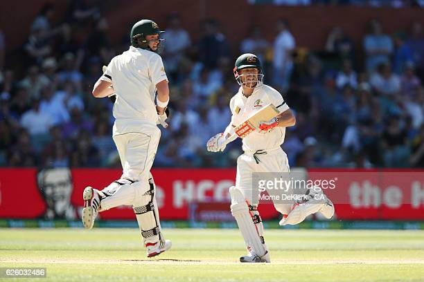 Matt Renshaw and David Warner of Australia run between the wickets during day four of the Third Test match between Australia and South Africa at...
