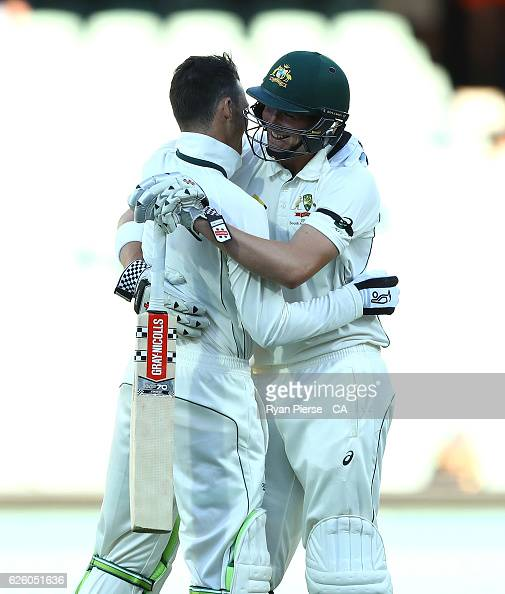 Matt Renshaw of Australia and Peter Handscomb of Australia celebrate after hitting the winning runs during day four of the Third Test match between...