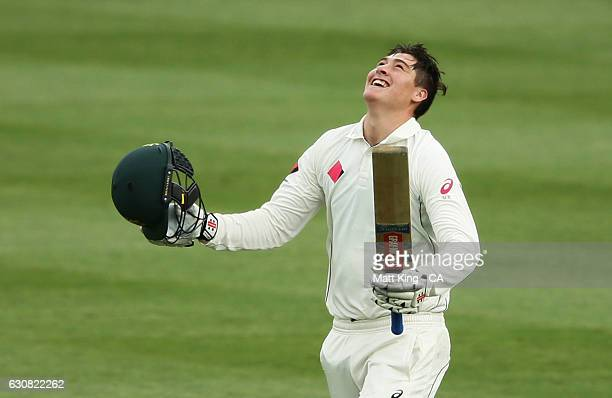 Matt Renshaw of Australia celebrates and acknowledges the crowd after scoring a century during day one of the Third Test match between Australia and...