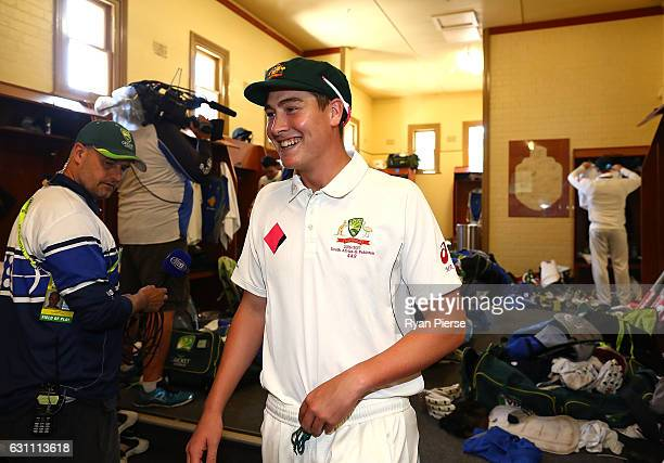 Matt Renshaw of Australia celebrates in the change rooms after day five of the Third Test match between Australia and Pakistan at Sydney Cricket...
