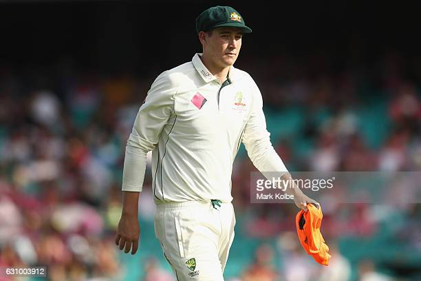Matt Renshaw of Australia leaves the field after being struck on the helmet while fielding during day three of the Third Test match between Australia...