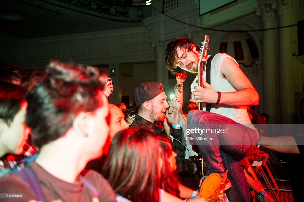 Matt Reynold of Baby Godzilla performs along the front row during the last night of the Kerrang Tour onstage at Brixton Academy on February 21, 2014 in London, United Kingdom.