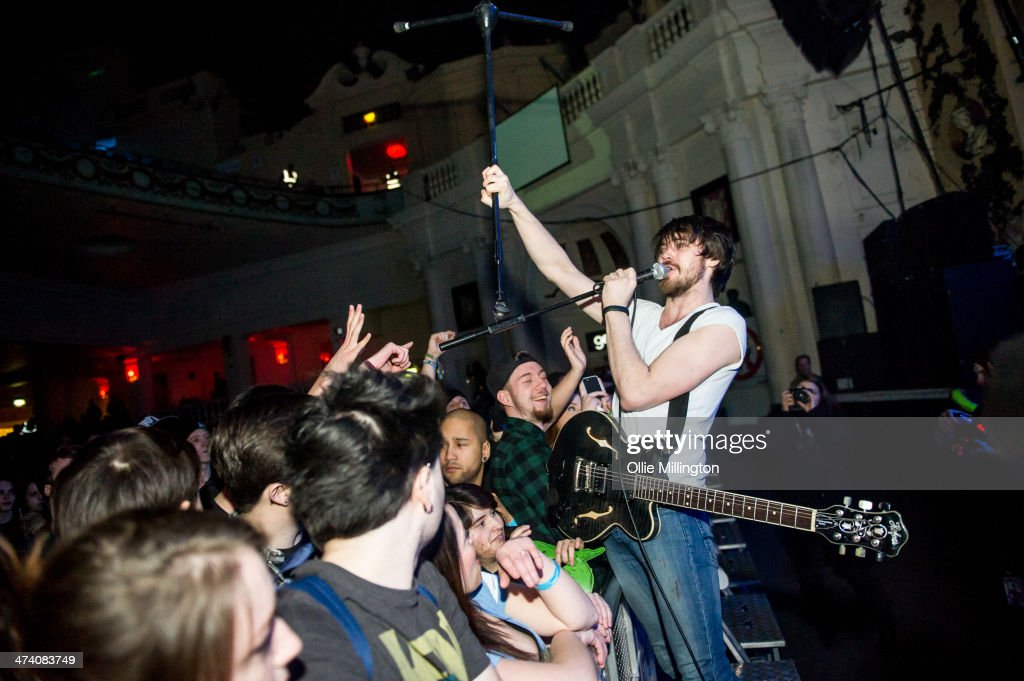 Matt Reynold of Baby Godzilla performs infront of the front row during the last night of the Kerrang Tour at Brixton Academy on February 21, 2014 in London, United Kingdom.