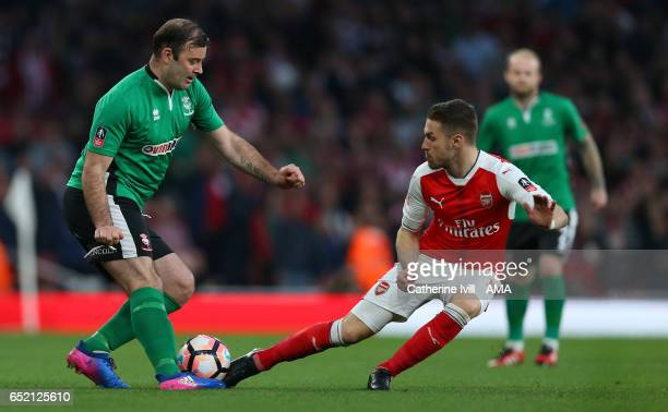 Matt Rhead of Lincoln City and Aaron Ramsey of Arsenal during The Emirates FA Cup QuarterFinal match between Arsenal and Lincoln City at Emirates...