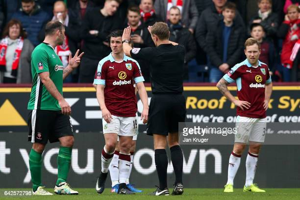 Matt Rhead of Lincoln City and Joey Barton of Burnley exchange words during The Emirates FA Cup Fifth Round match between Burnley and Lincoln City at...