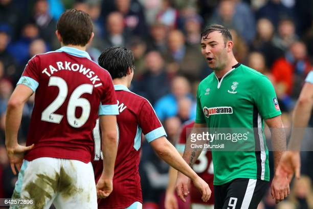 Matt Rhead of Lincoln City argues with Joey Barton of Burnley during The Emirates FA Cup Fifth Round match between Burnley and Lincoln City at Turf...