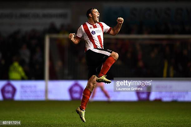 Matt Rhead of Lincoln City celebrates during the Emirates FA Cup third round replay between Lincoln City and Ipswich Town at Sincil Bank Stadium on...