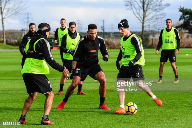 Matt Ritchie controls the ball whilst Jamaal Lascelles looks to challenge during the Newcastle United Training session at The Newcastle United...