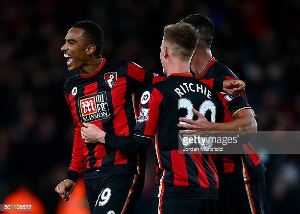 Matt Ritchie Junior Stanislas and Andrew Surman of Bournemouth celebrate after the final whistle in the Barclays Premier League match between AFC...