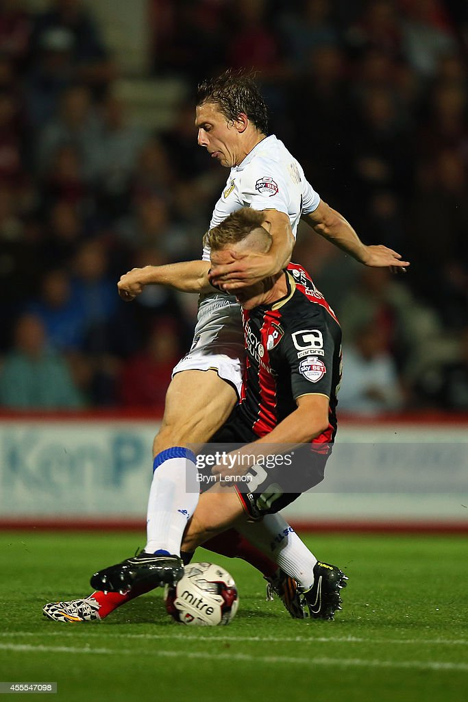 Matt Ritchie of AFC Bournemouth battles with Stephen Warnock of Leeds United during the Sky Bet Championship match between AFC Bournemouth and Leeds United at Goldsands Stadium on September 16, 2014 in Bournemouth, England.