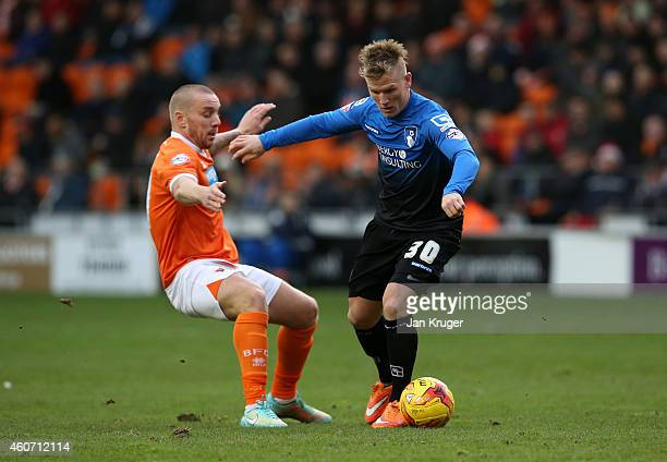 Matt Ritchie of AFC Bournemouth shields the ball from Jamie O'Hara of Blackpool during the Sky Bet Championship match between Blackpool and...