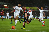 Matt Ritchie of Bournemouth and Kyle Bartley of Swansea City compete for the ball during the Barclays Premier League match between Swansea City and...