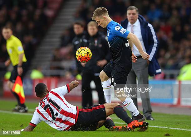 Matt Ritchie of Bournemouth and Yann M'Vila of Sunderland compete for the ball during the Barclays Premier League match between Sunderland and AFC...