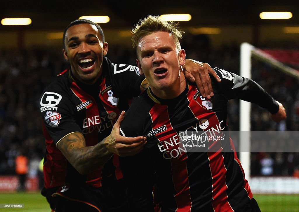 Matt Ritchie of Bournemouth (R) celebrates with Callum Wilson as he scores their first goal during the Sky Bet Championship match between AFC Bournemouth and Derby County at Goldsands Stadium on February 10, 2015 in Bournemouth, England.