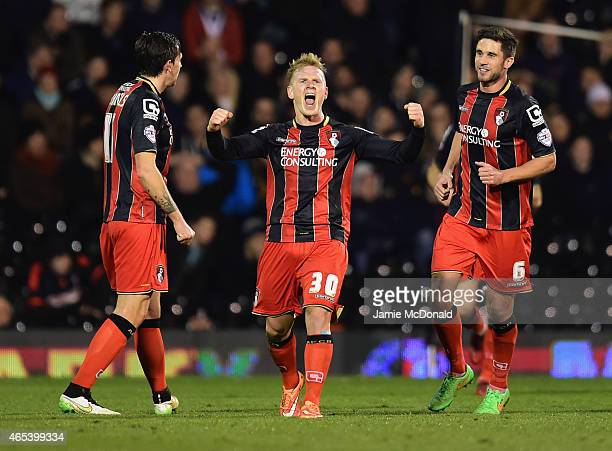 Matt Ritchie of Bournemouth celebrates with team mates as he scores their second goal during the Sky Bet Championship match between Fulham and AFC...