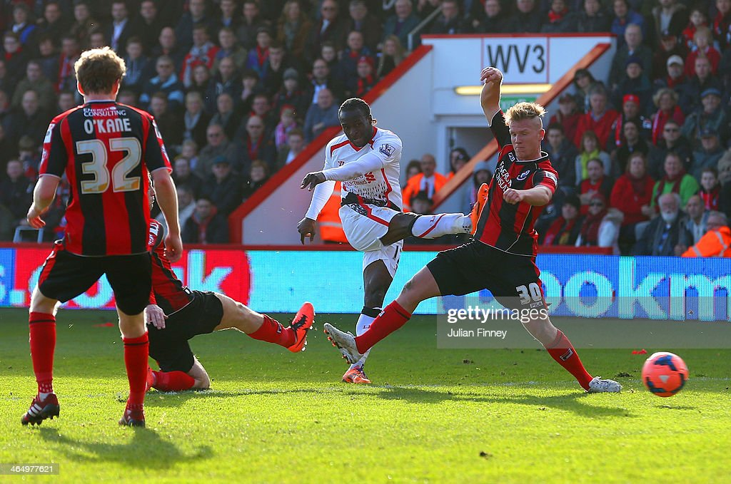 Matt Ritchie of Bournemouth fails to block <a gi-track='captionPersonalityLinkClicked' href=/galleries/search?phrase=Victor+Moses&family=editorial&specificpeople=2649383 ng-click='$event.stopPropagation()'>Victor Moses</a> of Liverpool as he scores the opening goal during the FA Cup Fourth Round match between Bournemouth and Liverpool at Goldsands Stadium on January 25, 2014 in Bournemouth, England.