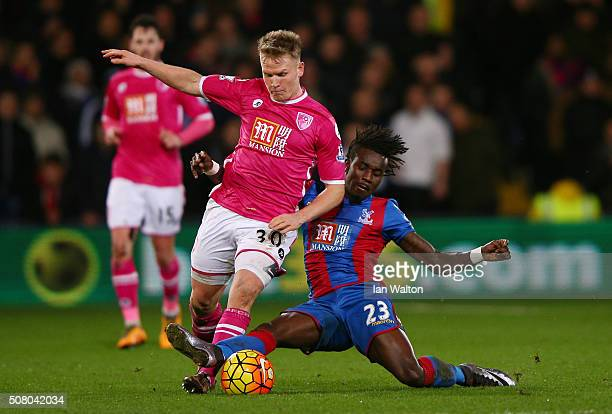 Matt Ritchie of Bournemouth is tackled by Pape N'Diaye Souare of Crystal Palace during the Barclays Premier League match between Crystal Palace and...